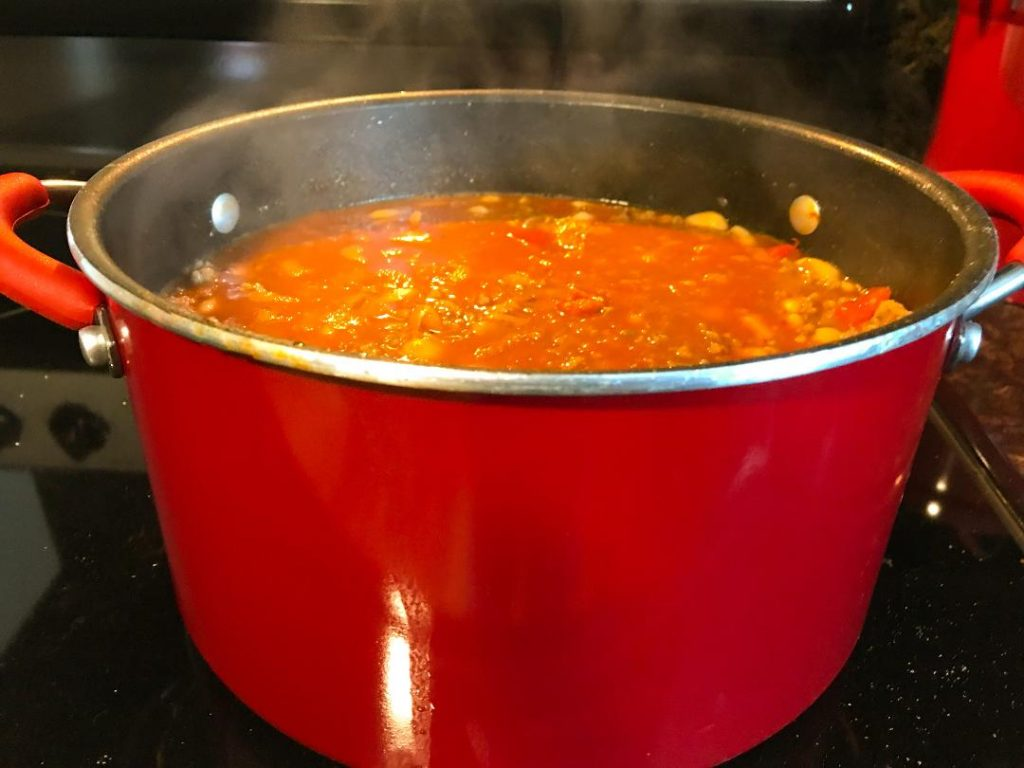 Italian Chili made with Italian hot sausage, Italian mild sausage, Cannellini white kidney beans, dry red wine, fire roasted diced tomatoes, diced white or yellow onion, chopped garlic cloves, tomato paste, chicken broth, crushed red pepper, sea salt, and pepper.